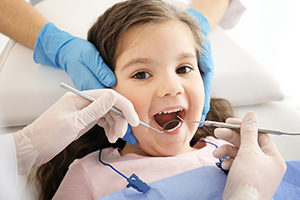 Family Dentistry of Pembroke Pines inspecting a Child's teeth during a routine visit