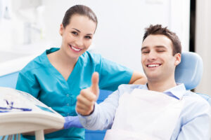 Root Canal Pembroke Pines Patient giving Thumbs Up